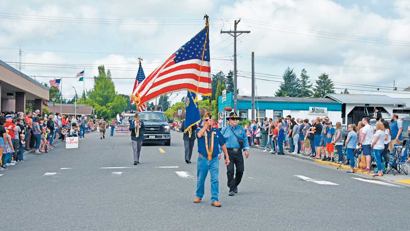 None of the parade-goers needed to be told to stand when the American Legion presented the colors.